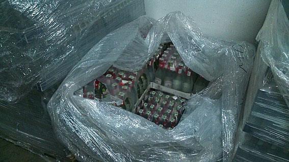 Полмиллиона бутылок фальшивой водки изготовил завод вХарьковской области