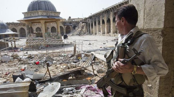 Террористы обстреляли гуманитарный коридор вАлеппо