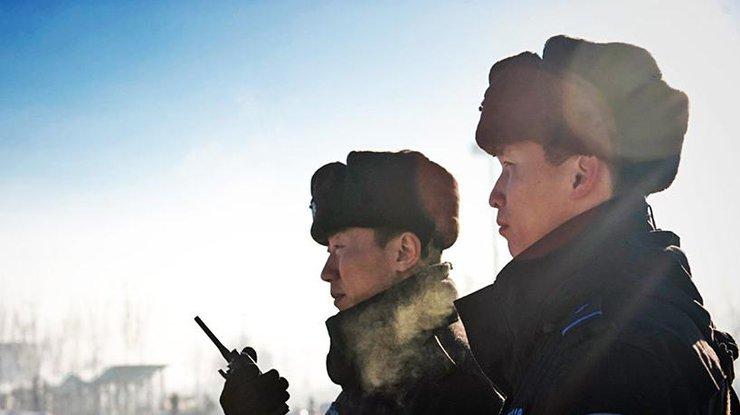 В КНР террористы-смертники атаковали правительственное сооружение