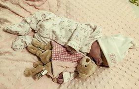 Фото с мертвым малышом