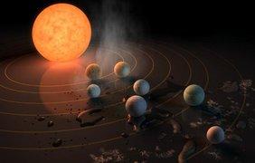 На первых двух планетах слишком жарко,на последних - слишком холодно. Рис. NASA