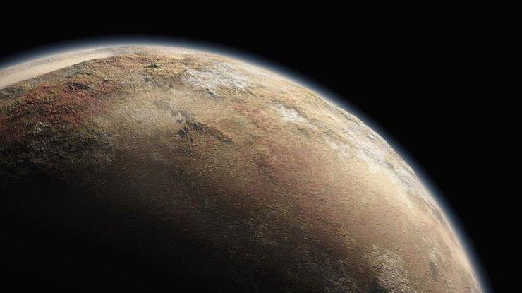 NASA показало видео поверхности заледеневшего Плутона иего спутника