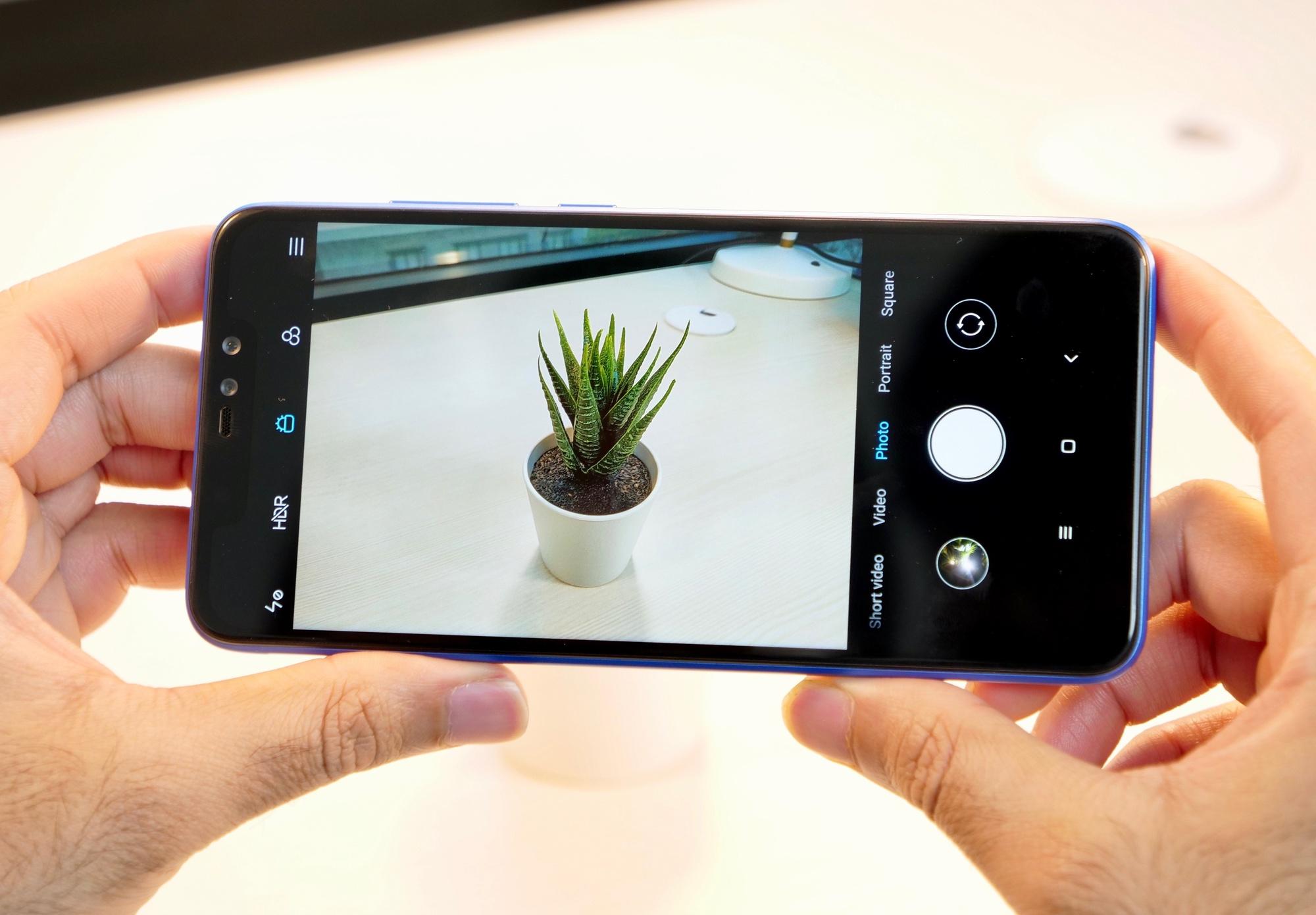 мобильный телефон с лучшей фотокамерой отражения света стеклянной