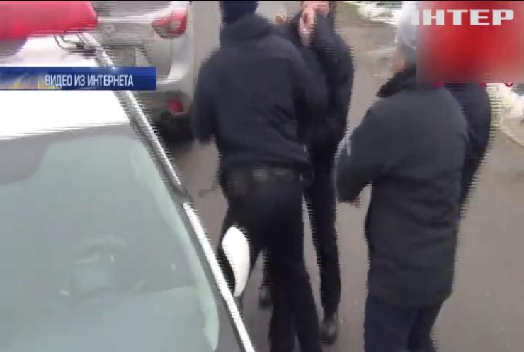 В Николаеве полиция избила активистов Дорожного контроля