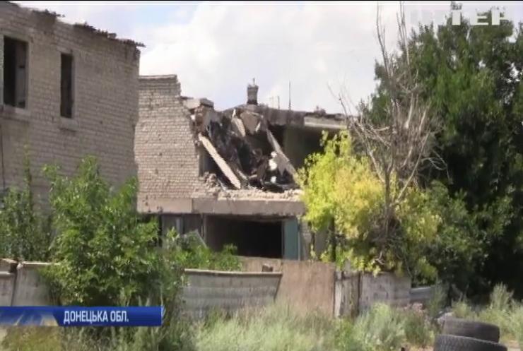 Під Мар'їнкою під ворожі обстріли потрапили житлові будинки