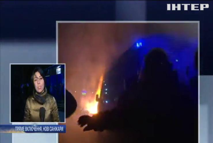 Протести, силовики і бронетехніка: як Україна зустріла евакуйованих з Уханя