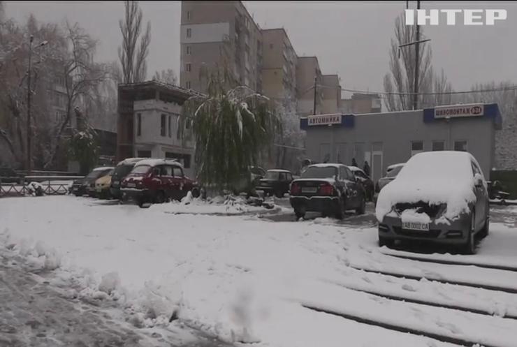 Україну накриє дощем та мокрим снігом
