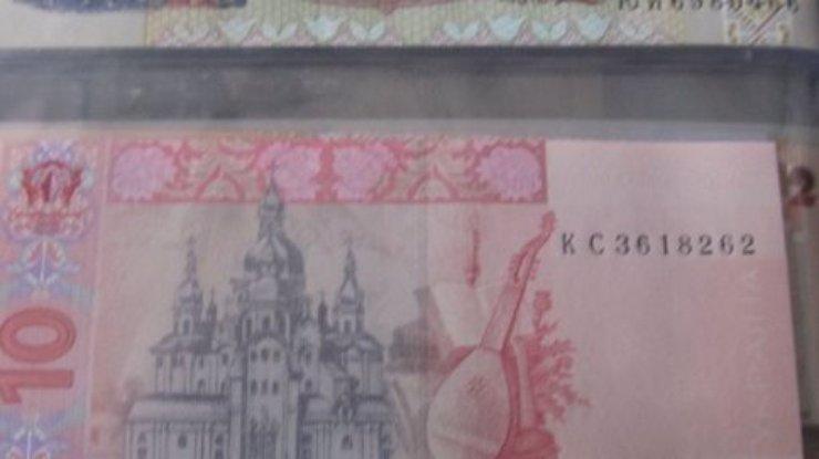 Как определить фальшивые деньги от настоящих