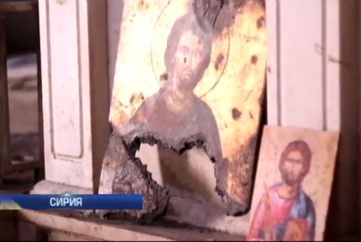 ИГИЛ в Сирии вешает христиан и уничтожает храмы (видео)