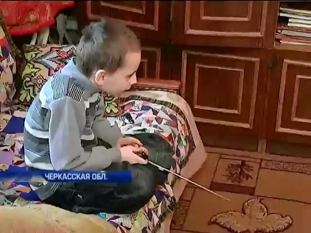 Сироте Максиму отказывают в компенсации за убитого на Донбассе отца (видео)